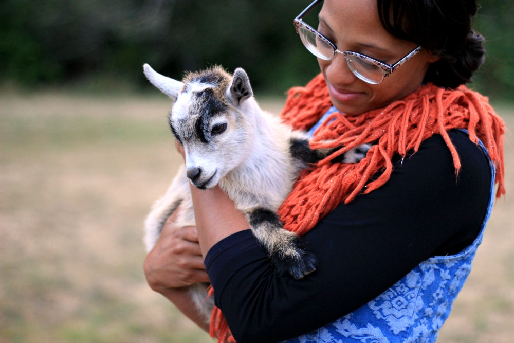 Cherelle German, owner of Floral and Stripe event and wedding decorator with baby goat from The Inspired Prairie